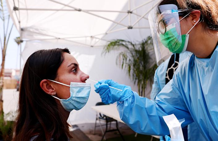 National Nurses United is urging the CDC to reinstate universal masking recommendations for people, regardless of their vaccination status. (Photo by Mario Tama/Getty Images)