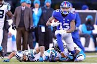 Dec 20, 2015; East Rutherford, NJ, USA; New York Giants wide receiver Odell Beckham Jr. (13) runs the ball past Carolina Panthers cornerback Cortland Finnegan (26) and defensive back Charles Tillman (31) during the fourth quarter at MetLife Stadium. The Panthers defeated the Giants 38-35. Mandatory Credit: Brad Penner-USA TODAY Sports