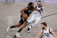 Brooklyn Nets guard James Harden (13) drives past Dallas Mavericks guard Josh Richardson during the second half of an NBA basketball game Saturday, Feb. 27, 2021, in New York. (AP Photo/John Minchillo)