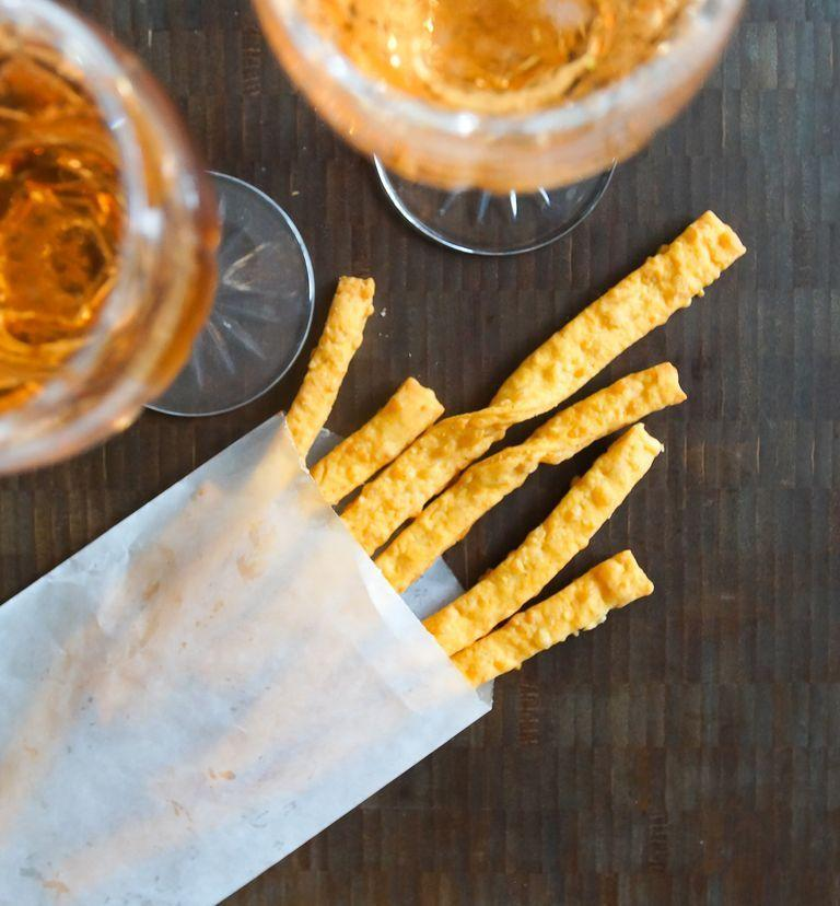 """<p>Cheese straws never fail to please. They're a delicious snack served with wine or cocktails, plus the kids will love them, too! </p><p><a href=""""https://www.thepioneerwoman.com/food-cooking/recipes/a100645/cheese-straws/"""" rel=""""nofollow noopener"""" target=""""_blank"""" data-ylk=""""slk:Get the recipe."""" class=""""link rapid-noclick-resp""""><strong>Get the recipe.</strong></a></p><p><a class=""""link rapid-noclick-resp"""" href=""""https://go.redirectingat.com?id=74968X1596630&url=https%3A%2F%2Fwww.walmart.com%2Fsearch%3Fq%3Dwine%2Bglasses&sref=https%3A%2F%2Fwww.thepioneerwoman.com%2Ffood-cooking%2Fmeals-menus%2Fg37320750%2Fthanksgiving-appetizers%2F"""" rel=""""nofollow noopener"""" target=""""_blank"""" data-ylk=""""slk:SHOP WINE GLASSES"""">SHOP WINE GLASSES</a></p>"""