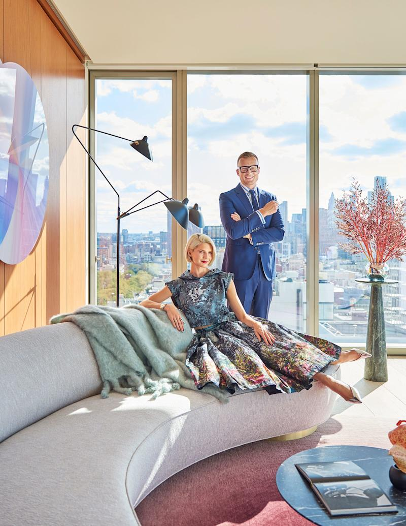 """Samantha Angelo, a fashion stylist and designer, and her husband, Peter Ostrega, a legal technology consultant, live in this light-flooded apartment atop Ian Shrager's Public Hotel on the Lower East Side of Manhattan. The building, which has 11 residential units, was designed by Herzog & de Meuron, with interior architecture by minimalist master John Pawson. The couple, who are frequently photographed at social events wearing glamorous and somewhat retro ensembles, say they've had an """"incredible journey"""" since arriving in New York City in 2014. Back then, they lived in a creaky old apartment on Mott Street, where they could see the construction of the high-rise they now call home. """"We started fantasizing about living in a space like that but had no way of accomplishing it at the time,"""" says Ostrega, who emigrated from Poland to the United States as a child, at a time when his country had imposed martial law. Angelo, who played the clarinet with the United States Marine Band for almost a decade, quit her position to start a new career as a stylist and creative director. Armann Ortega of AO Atelier helped the couple with the home's interior design."""