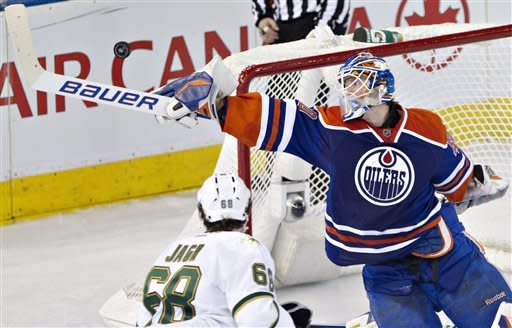 Dallas Stars' Jaromir Jagr (68) is stopped by Edmonton Oilers goalie Devan Dubnyk during the second period of an NHL hockey game Wednesday, Feb. 6, 2013, in Edmonton, Alberta. (AP Photo/The Canadian Press, John Franson)