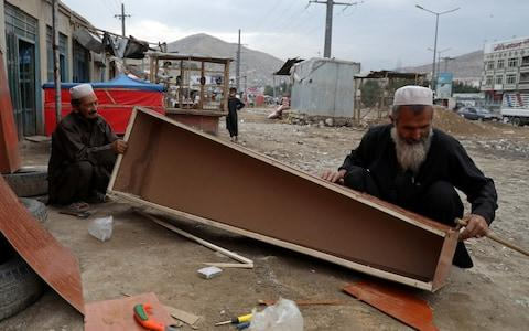 Afghan carpenters prepare coffins for sale at their shop in Kabul, Afghanistan, July 29, 2019. REUTERS/ - Credit: Reuters