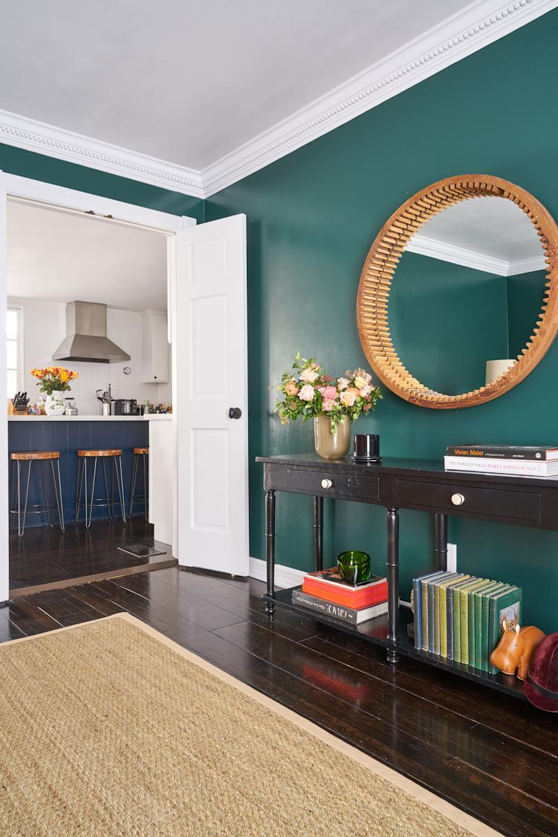The mirror in the dining room, painted in Benjamin Moore's Hunter Green, is made from an old wooden shipping mold.