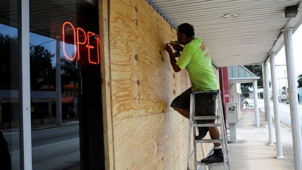 PHOTO: A man boards up a business ahead of the arrival of Hurricane Dorian in Cocoa, Fla., Sept. 1, 2019. (Marco Bello/Reuters)