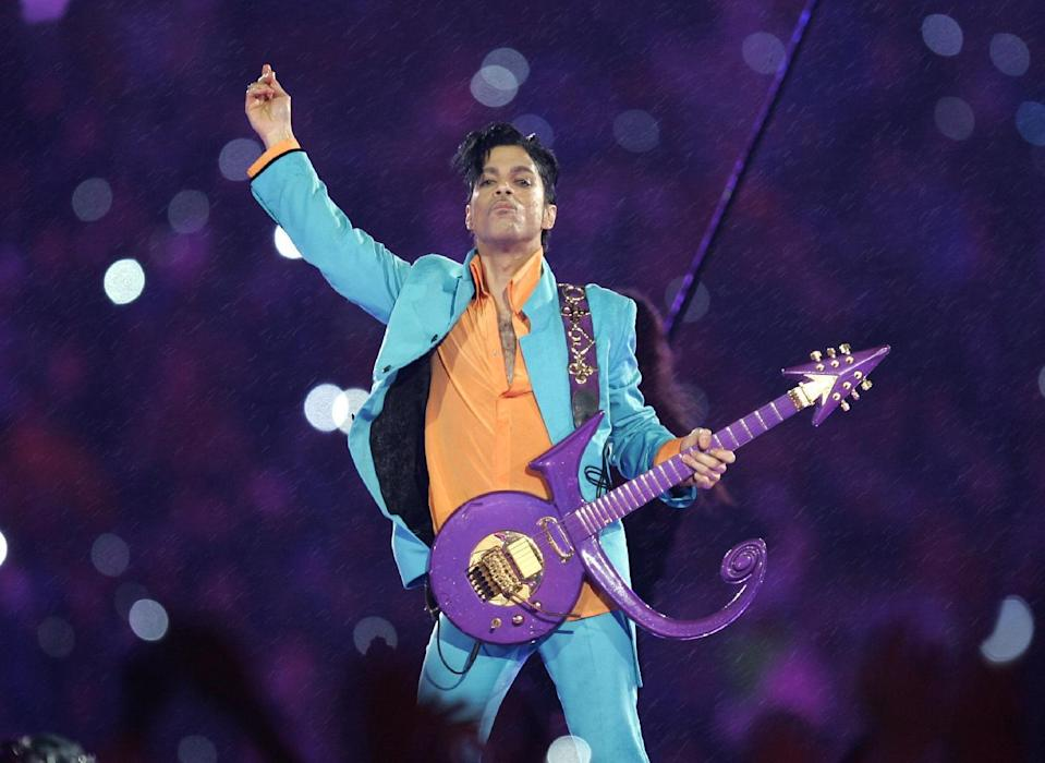 FILE - In this Feb. 4, 2007, file photo, Prince performs during the halftime show at the Super Bowl XLI football game at Dolphin Stadium in Miami. The Grammy Awards announced Wednesday Feb. 8, 2017, that Sunday's show will include tribute performances in honor of Prince and George Michael. Both stars died last year. (AP Photo/Chris O'Meara, File)