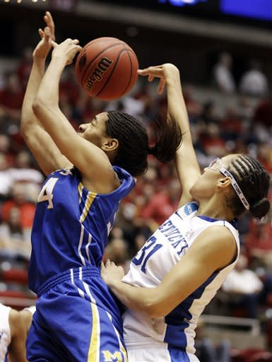Kentucky center Samantha Drake, right, blocks a shot by McNeese State forward Martika Hull during the second half of an NCAA tournament first-round women's college basketball game, Saturday, March 17, 2012, in Ames, Iowa. (AP Photo/Charlie Neibergall)