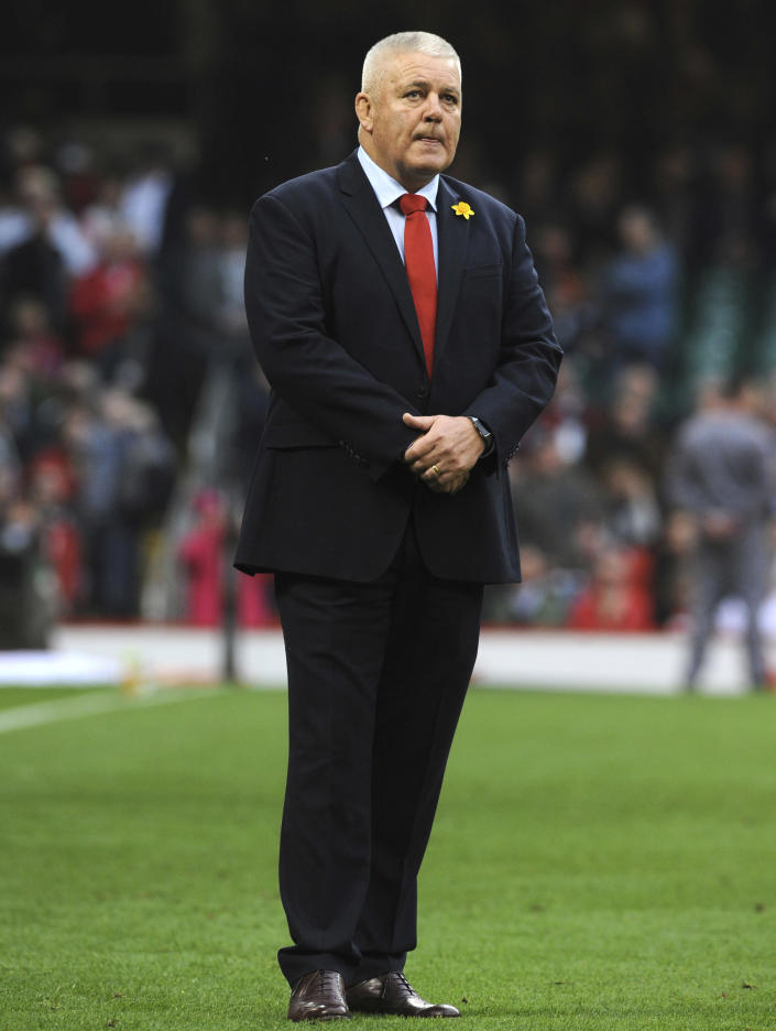 FILE - In this file photo dated Saturday, Feb. 23, 2019, Wales head coach Warren Gatland watches his players ahead of their Six Nations rugby union international between against England at the Principality Stadium in Cardiff, Wales. Gatland has been hammering home to his Wales side to relish their uncommon shot at a Six Nations Grand Slam, ahead of their deciding match against Ireland on upcoming Saturday March 16, 2019.(AP Photo/Rui Vieira, FILE)