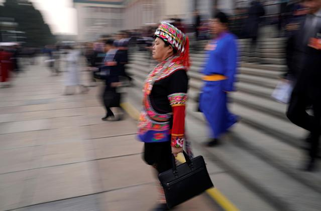 <p>An ethnic minority delegate leaves the Great Hall of the People after the second plenary session of the National People's Congress (NPC) in Beijing on March 9, 2018. (Photo: Jason Lee/Reuters) </p>