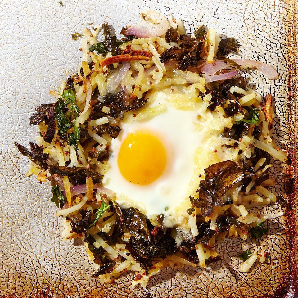 "<p>This potato and kale hash recipe is just as fun to make as it is to eat. After the potatoes and kale are roasted, the hash is formed into 4 individual ""nests"" that are finished with an egg in the middle. To keep the prep work to a minimum, use pre-chopped kale, found near other prepared cooking greens. If you'd rather chop your own, start with about 1 bunch and strip the leaves off the stems before chopping.</p>"