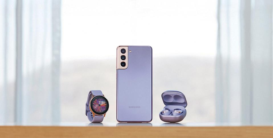 The Samsung Galaxy S21+ smartphone, which starts at $999.99 and is available for pre-order Thursday, shown here with Galaxy smartwatch and new Galaxy Buds Pro ($199.99). The S21+ will be available in a new color, Phantom Violet, as well as Phantom Silver, Phantom Black, and (on Samsung.com) Phantom Gold and Phantom Red.