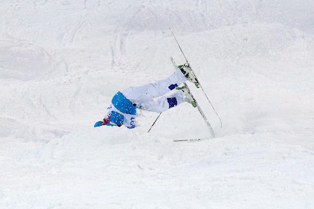 SOCHI, RUSSIA - FEBRUARY 10: Ville Miettunen of Finland crashes out in the Men's Moguls Qualification on day three of the Sochi 2014 Winter Olympics at Rosa Khutor Extreme Park on February 10, 2014 in Sochi, Russia. (Photo by Cameron Spencer/Getty Images)
