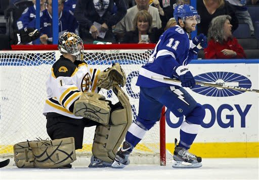 Tampa Bay Lightning's Tom Pyatt, right, celebrates his goal past Boston Bruins goalie Marty Turco during the first period of an NHL hockey game Tuesday, March 13, 2012, in Tampa, Fla. (AP Photo/Mike Carlson)