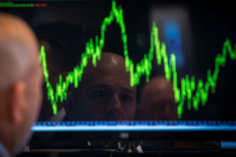 FILE PHOTO: FILE PHOTO: A Specialist trader watches his chart while working on the floor of the New York Stock Exchange