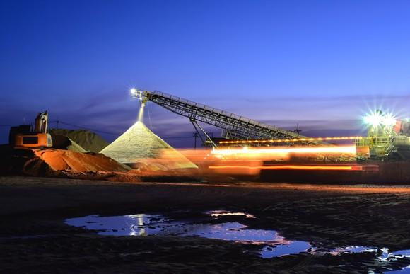 Sand mining at night.