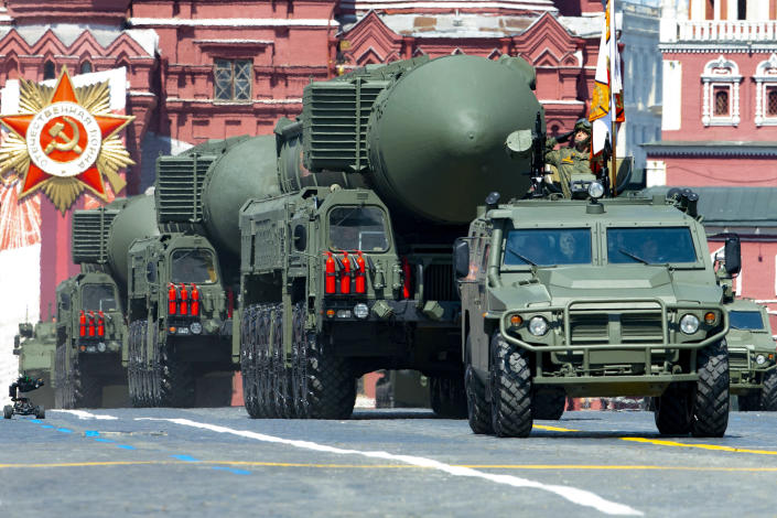 FILE - In this file photo taken on Wednesday, June 24, 2020, Russian RS-24 Yars ballistic missiles roll in Red Square during the Victory Day military parade marking the 75th anniversary of the Nazi defeat in Moscow, Russia. Russia and the United States exchanged documents Tuesday Jan. 26, 2021, to extend the New START nuclear treaty, their last remaining arms control pact, the Kremlin said. The Kremlin readout of a phone call between U.S. President Joe Biden and Russian President Vladimir Putin said they voiced satisfaction with the move. (AP Photo/Alexander Zemlianichenko, File)