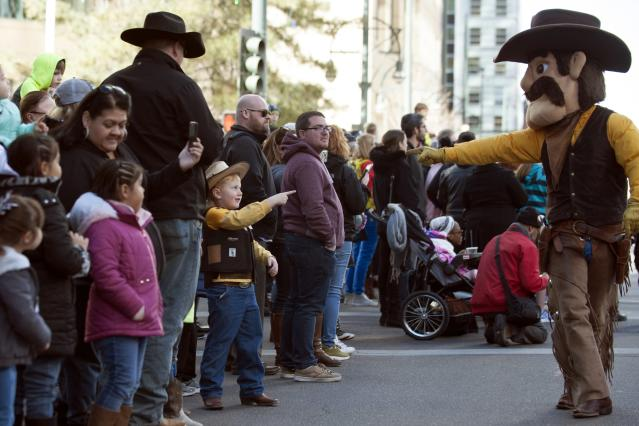 The University of Wyoming Cowboys' mascot, Pistol Pete, points to Blane Ritter, 5, during the National Western Stock Show parade in Denver on Jan. 4, 2018. (Photo: Jason Connolly/AFP/Getty Images)