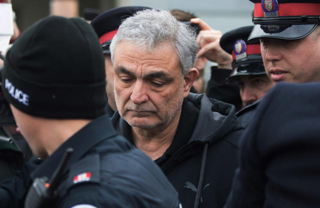 <p>Vahe Minassian, father of Alek Minassian, is surrounded by members of the media as he leaves court with a police escort in Toronto on Tuesday, April 24, 2018. (Photo: Chris Young/The Canadian Press via AP) </p>