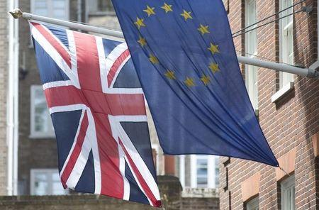The Union Flag flies next to the European Flag outside the European Commission building in central London