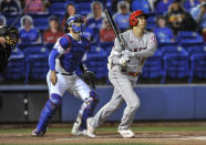 Los Angeles Angels' Shohei Ohtani watches his triple, next to Toronto Blue Jays catcher Steven Matz during the first inning of a baseball game Saturday, April 10, 2021, in Dunedin, Fla. (AP Photo/Steve Nesius)