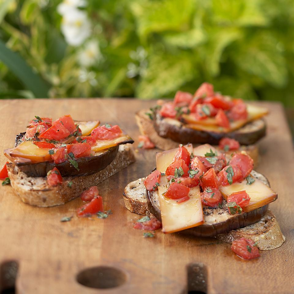 <p>Grilled eggplant slices topped with smoky Gouda cheese and herb-seasoned tomatoes make these vegetarian burgers into a dinner that even meat-lovers would enjoy.</p>