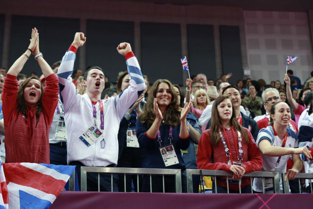 Kristian Thomas (2nd L), Catherine, Duchess of Cambridge, Rebecca Tunney (2nd R) and Beth Tweedle (R) cheer Britain's Louis Smith during the men's pommel horse competition in the North Greenwich Arena during the London 2012 Olympic Games August 5, 2012. REUTERS/Olivia Harris (BRITAIN - Tags: SPORT OLYMPICS ENTERTAINMENT ROYALS GYMNASTICS)