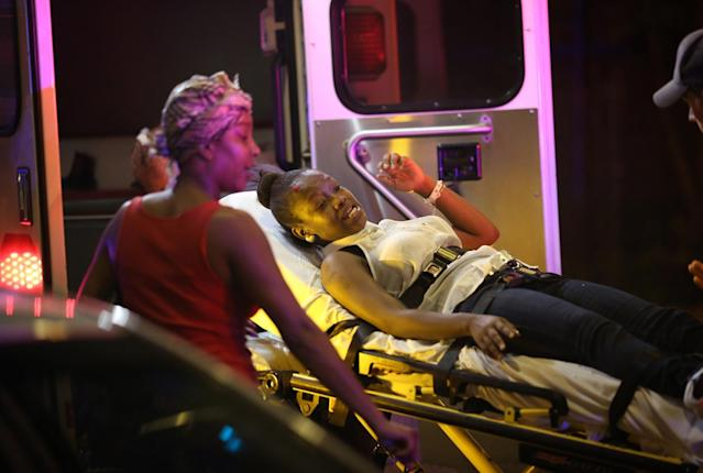 Emergency personnel transport victims from the scene where 12 people, including a 3-year-old, were shot at Cornell Square Park in the Back of the Yards neighborhood in Chicago on Sept. 19, 2013. (Photo: E. Jason Wambsgans/Chicago Tribune/MCT via Getty Images)