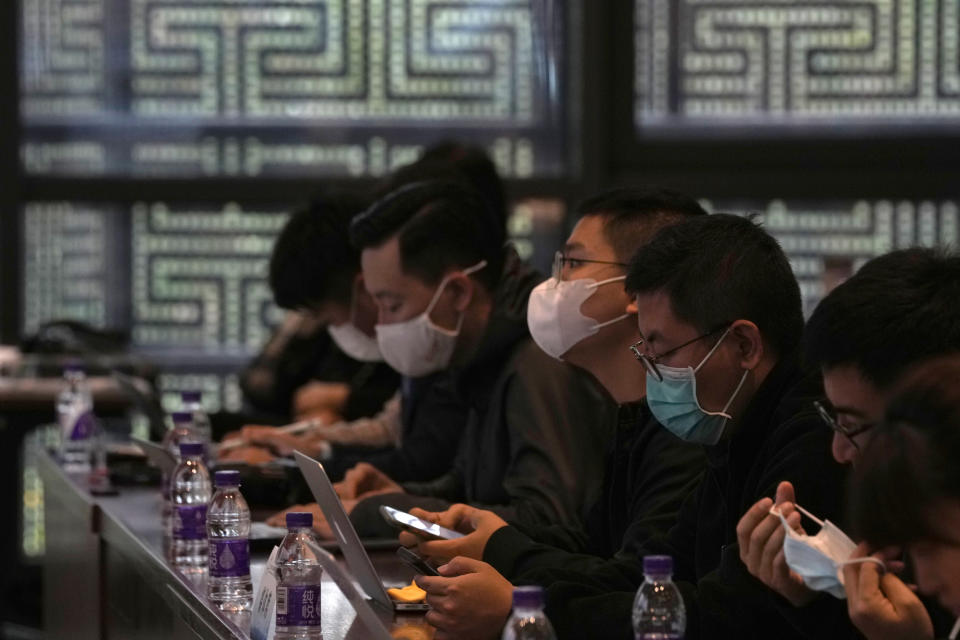 Journalists wearing masks attend a press conference held by the Beijing Winter Olympics Organizing Committee in Beijing Monday, Oct. 4, 2021. When the International Olympic Committee awarded Beijing the 2008 Summer Olympics, it promised the Games could improve human rights and civil liberties in China. (AP Photo/Ng Han Guan)