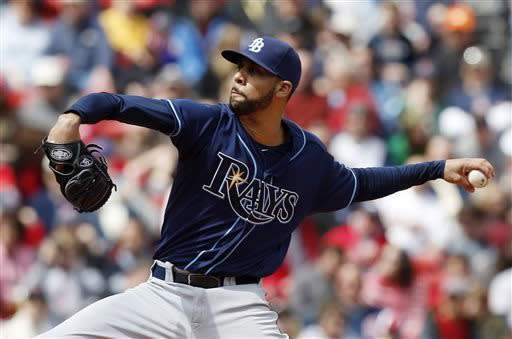 Tampa Bay Rays' David Price pitches in the first inning of a baseball game against the Boston Red Sox in Boston, Saturday, April 13, 2013. (AP Photo/Michael Dwyer)