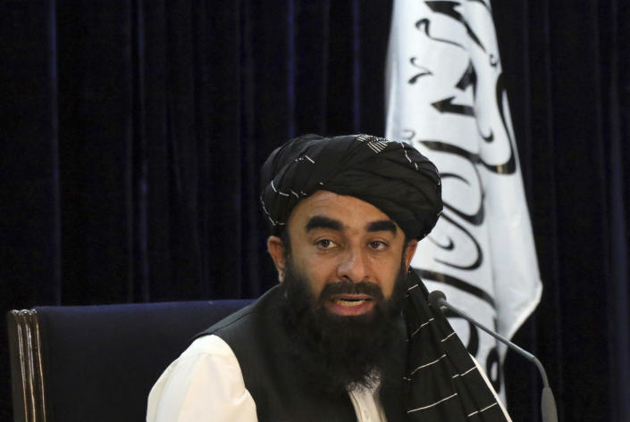 Taliban spokesman Zabihullah Mujahid speaks during a press conference in Kabul, Afghanistan Tuesday, Sept. 7, 2021. The Taliban on Tuesday announced a caretaker Cabinet stacked with veterans of their harsh rule in the late 1990s and subsequent 20-year battle against the U.S.-led coalition and its Afghan government allies. The line-up announced at the press conference is not likely to win the international support the Taliban so desperately need to avoid an economic meltdown. (AP Photo/Muhammad Farooq)