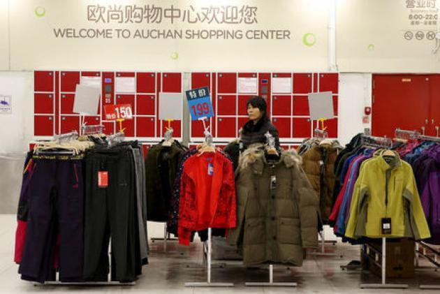 China's Sun Art partners Alibaba to boost store efficiency; shares jump