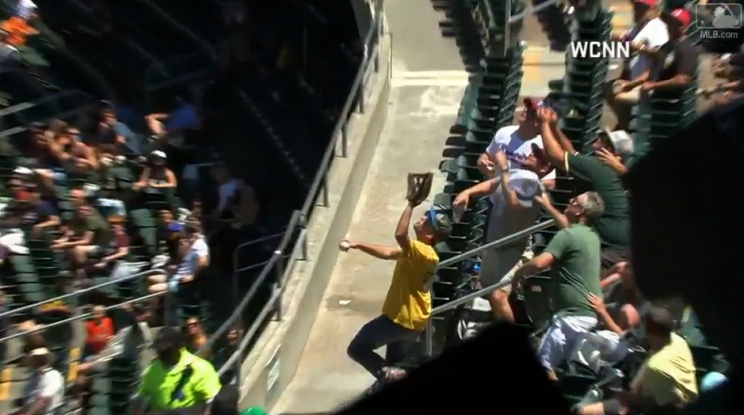 Luckiest Athletics fan ever catches his second of three foul balls in the same game. (MLB.com)