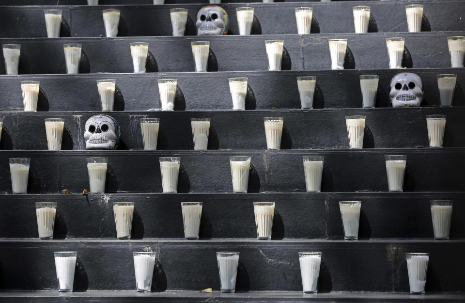 A Day of the Dead altar adorned with candles and skulls sits inside Senate in Mexico City, Saturday, Oct. 31, 2020. Mexico's Day of the Dead celebration won't be the same in a year so marked by death after more than 90,000 people have died of COVID-19. (AP Photo/Ginnette Riquelme)