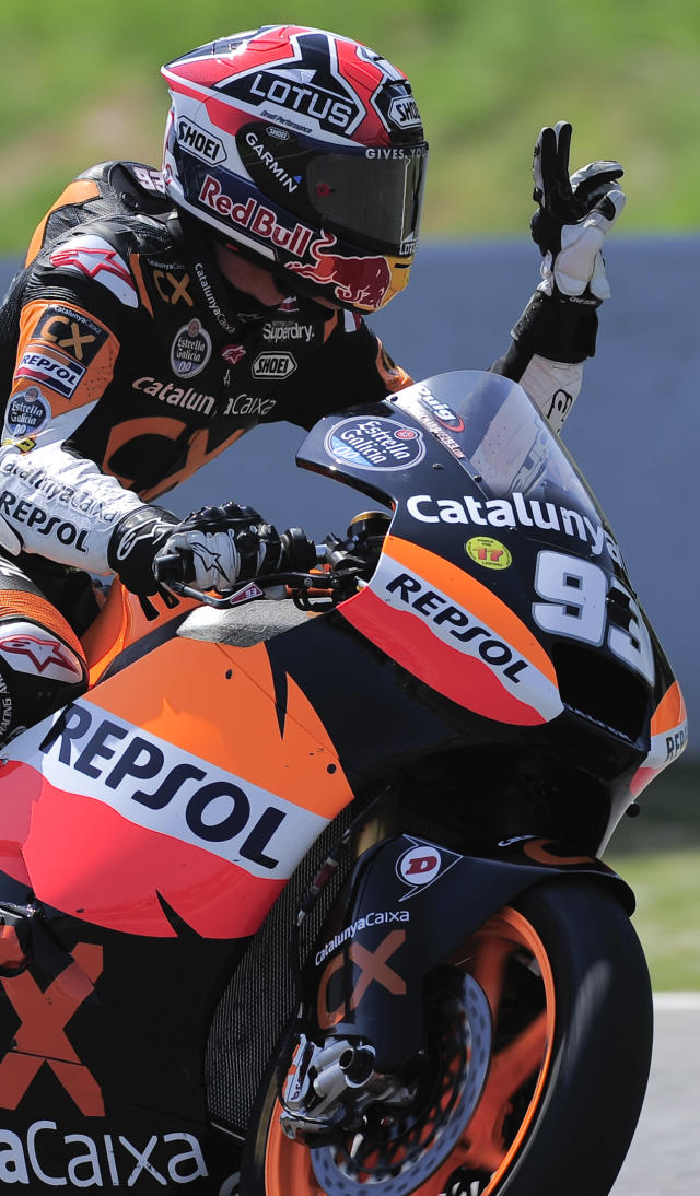 Team Catalunyacaixa Repsol's Spanish Marc Marquez celebrates after taking the pole position at the Catalunya racetrack in Montmelo, near Barcelona, on June 2, 2012, during Moto2 qualifying session of the Catalunya Moto GP Grand Prix. AFP PHOTO / JOSEP LAGOJOSEP LAGO/AFP/GettyImages