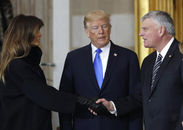 <p>First lady Melania Trump shakes hands with the Rev Bill Graham's son Franklin Graham as President Donald Trump looks on during ceremonies in the U.S. Capitol Rotunda as the remains of the late Rev. Billy Graham lie in honor in Washington, Feb. 28, 2018. (Photo: Jonathan Ernst/Reuters) </p>