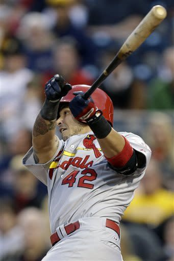 St. Louis Cardinals Yadier Molina drives in a run with a double off Pittsburgh Pirates starting pitcher James McDonald during the second inning of a baseball game in Pittsburgh on Monday, April 15, 2013. (AP Photo/Gene J. Puskar)
