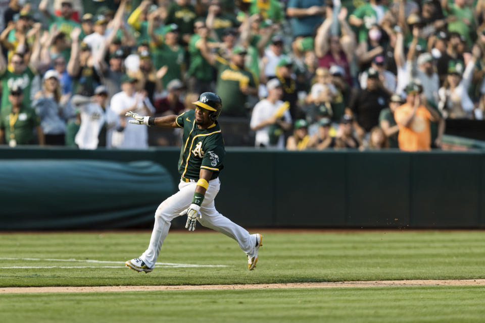 Oakland Athletics' Elvis Andrus runs home to score a walk-off win against the Houston Astros in the ninth inning of a baseball game in Oakland, Calif., Saturday, Sept. 25, 2021. The Athletics won 2-1. (AP Photo/John Hefti)