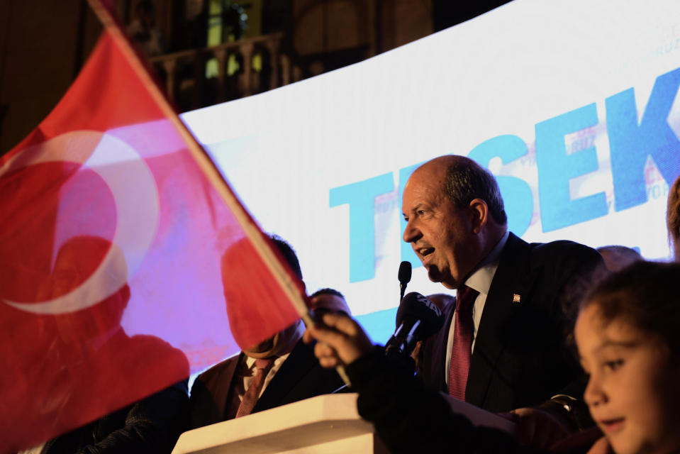 The newly elected Turkish Cypriot leader Ersin Tatar talks to his supporters after winning the Turkish Cypriots election in the Turkish occupied area in the north part of the divided capital Nicosia, Cyprus, Sunday, Oct. 18, 2020. Ersin Tatar, a hardliner who favors even closer ties with Turkey and a tougher stance with rival Greek Cypriots in peace talks has defeated the leftist incumbent in the Turkish Cypriot leadership runoff. (AP Photo/Nedim Enginsoy)
