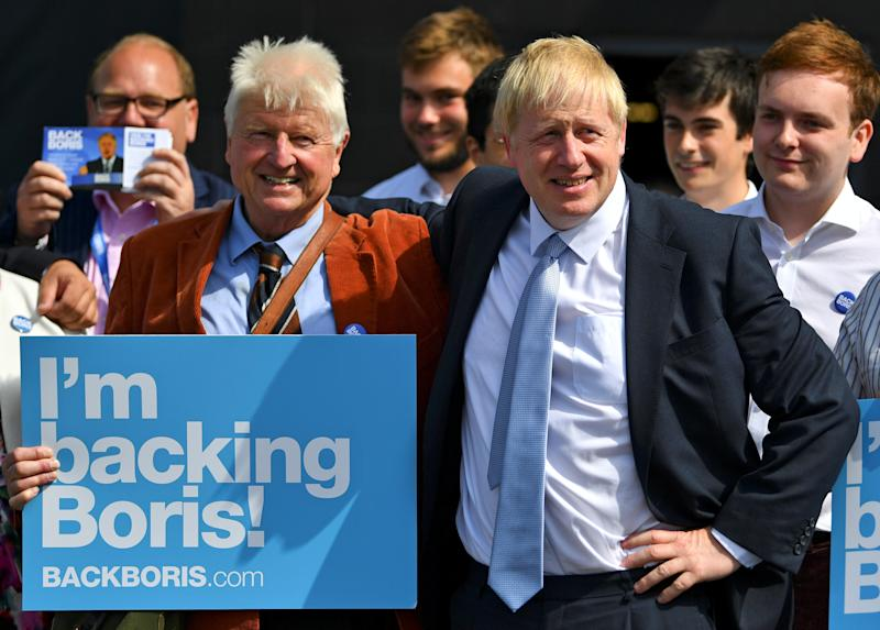 Britain's Conservative Party leadership candidate Boris Johnson and his father Stanley are seen at a hustings event, in Exeter, Britain, June 28, 2019. REUTERS/Dylan Martinez