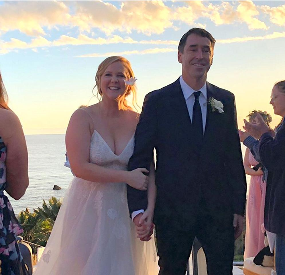 """The<em>I Feel Pretty</em>actress was caught completely by surprise when <a href=""""http://people.com/movies/amy-schumer-proposal-story-night/"""" target=""""_blank"""">Chris Fischer woke her up and handed her an engagement ring</a>. """"I got you this,"""" he said, and asked if she wanted him to get down on one knee. Schumer, wearing ear plugs and a night mask, said no to the knee but yes to the award-winning chef's proposal (and <a href=""""http://people.com/movies/amy-schumer-boyfriend-chris-fischer-married/"""" target=""""_blank"""">married him in a spur-of the-moment wedding</a> less than a week later)."""