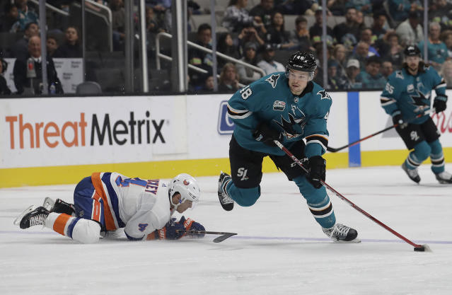 San Jose Sharks center Tomas Hertl (48), from the Czech Republic, skates past New York Islanders defenseman Thomas Hickey (4) during the first period of an NHL hockey game in San Jose, Calif., Saturday, Oct. 20, 2018. (AP Photo/Jeff Chiu)