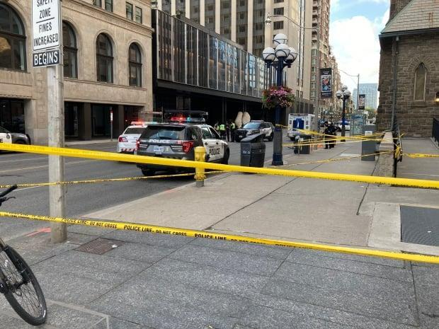 An 18-year-old is dead after he was hit by a dump truck while cycling at Avenue Road and Bloor Street West on Wednesday evening. Toronto police have taped off the area. (Michael Aitkens/CBC - image credit)