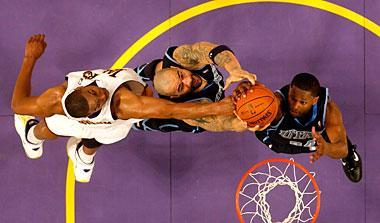 Andrew Bynum battles against Carlos Boozer (center) and C.J. Miles