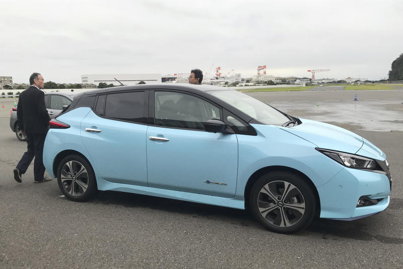 "In this Oct. 18, 2019, photo, Nissan's electric vehicle with new ""all-wheel-control"" technology is ready for a demonstration to reporters at its Oppama test driving course in Yokosuka, near Tokyo. The electric car with smooth four-wheel drive and a virtual friend for the coming age of automated driving are among the technology in development from Nissan. The Japanese automaker is eager to put the scandal over its former star executive Carlos Ghosn behind it. Nissan's newly developed ""all-wheel-control"" technology delivers a sense of greater control and safety. (AP Photo/Yuri Kageyama)"