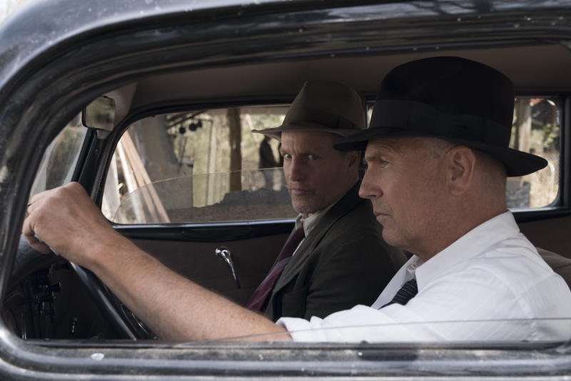 Kevin Costner and Woody Harrelson in 1930's era clothing sitting in a period car.