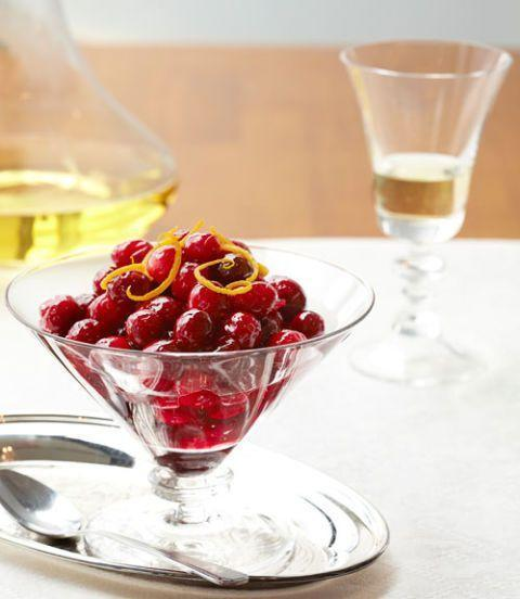 """<p>Simply simmer cranberries, sugar, maple syrup, and orange juice to make this light and simple sauce. </p><p><strong><em><a href=""""https://www.womansday.com/food-recipes/food-drinks/recipes/a39749/maple-orange-cranberry-sauce-recipe-ghk1113/"""" rel=""""nofollow noopener"""" target=""""_blank"""" data-ylk=""""slk:Get the Maple-Orange Cranberry Sauce recipe"""" class=""""link rapid-noclick-resp"""">Get the Maple-Orange Cranberry Sauce recipe</a>. </em></strong></p>"""