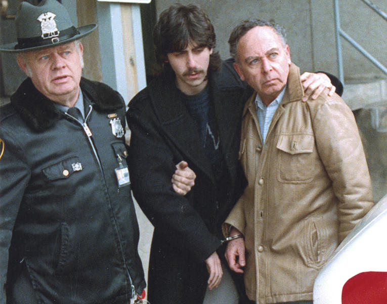 "FILE -This May 1989 file image shows Jesse Friedman, center, and his father, Arnold, right, under arrest from the documentary ""Capturing the Friedmans."" There is no reason to overturn the conviction of the younger Friedman in a notorious 1980s sex abuse scandal, prosecutors announced Monday, June 24, 2013, after a three-year review that was prompted in part by the 2003 Oscar-nominated documentary that questioned the prosecution. (AP Photo/HBO via Newsday, George Argerolos, File)"