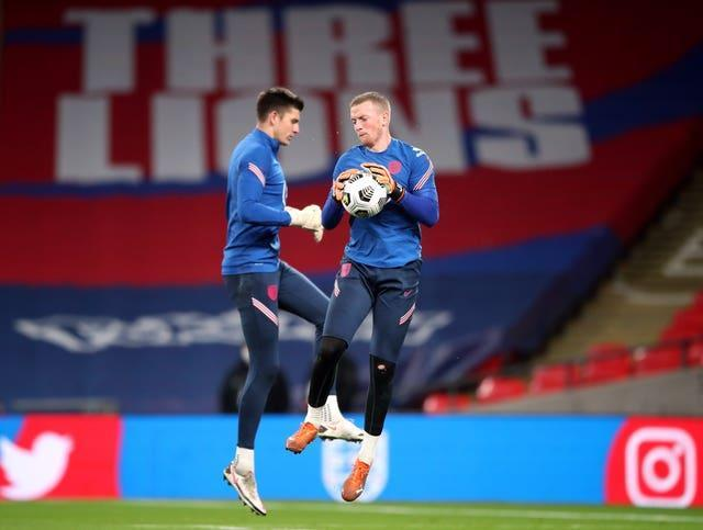 Nick Pope, left, is behind Jordan Pickford, right, in England's pecking order (Nick Potts/PA)