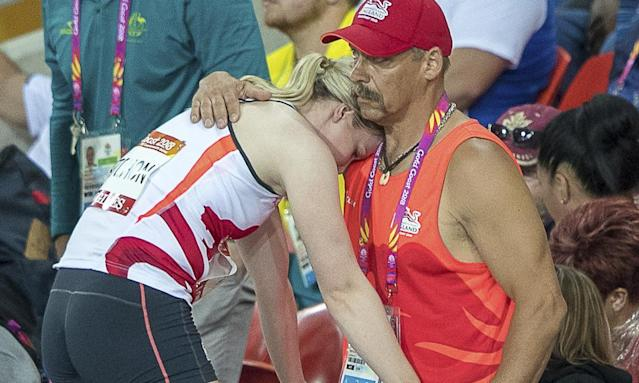 Sophie Hitchon, the Olympic bronze medallist in the hammer, is consoled by her coach after three no throws put her out of the competition.