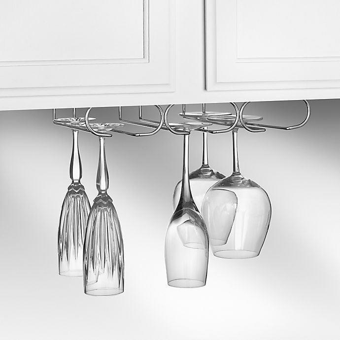 <p>This <span>Spectrum Under Cabinet Triple Stemware Holder</span> ($13) is so smart if you're lacking cabinet space.</p>